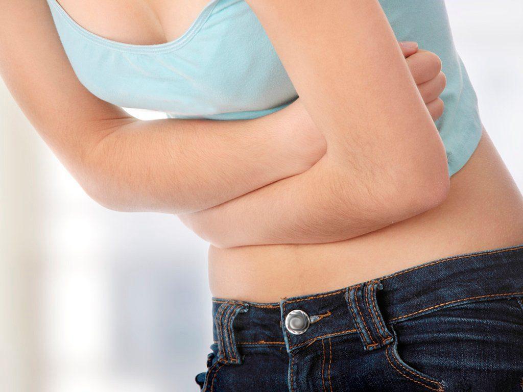боли в области желудка и спины